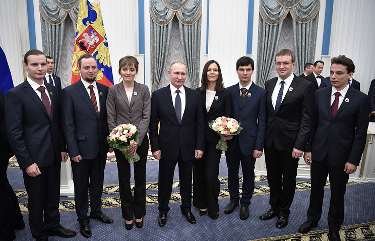 Russia's President Vladimir Putin with the winners of the 2016 Presidential Prize in Science and Innovation