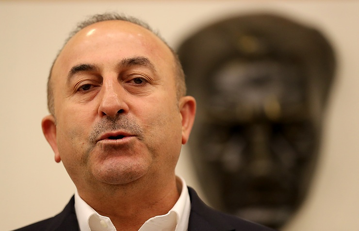 Mevlut Cavusoglu Turkish minister, in France, slams 'fascist' Netherlands