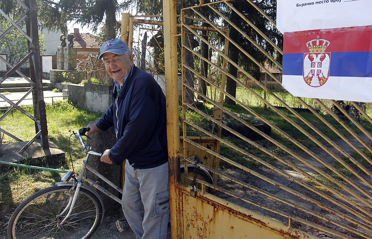 Local resident at the polling station after voting in presidential elections, Nis, Serbia