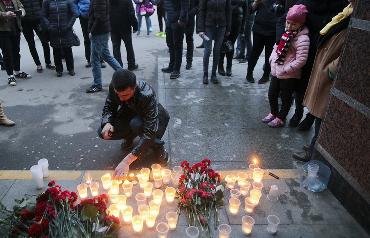 Flowers and candles at an entrance of Sennaya subway station after an explosion on the subway in St.Petersburg