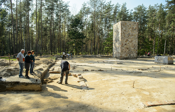Archeologists work on the site of the former Nazi Death Camp in Sobibor, Poland
