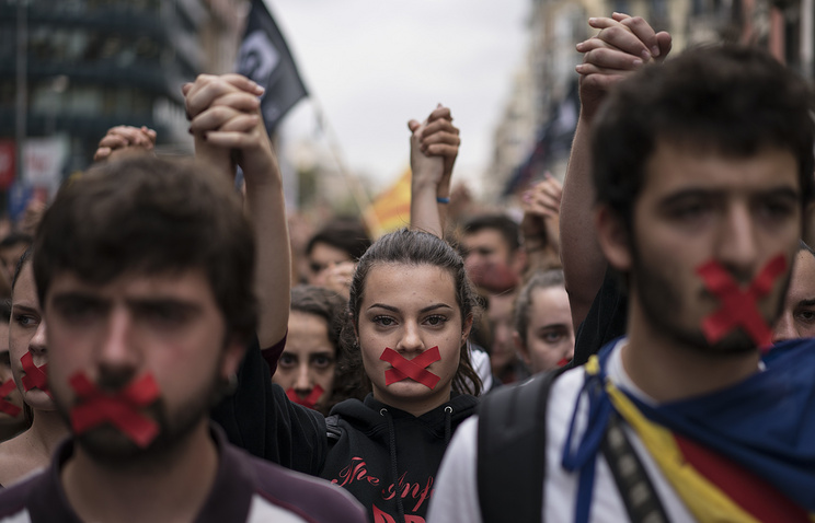 Independence supporters march during a demonstration downtown Barcelona, Spain