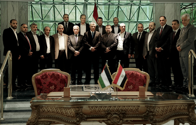Fatah and Hamas officials seen after a reconciliation deal in Cairo, Egypt
