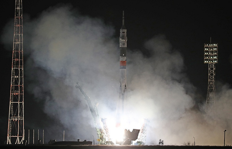 Soyuz lifts off with three-man crew