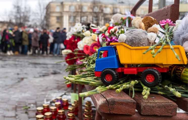 Flowers, candles and toys outside the Zimnyaya Vishnya shopping centre in Kemerovo where at least 64 people were killed in fire