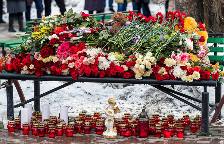 Flowers, candles and toys outside the Zimnyaya Vishnya shopping centre where over 60 people were killed in fire