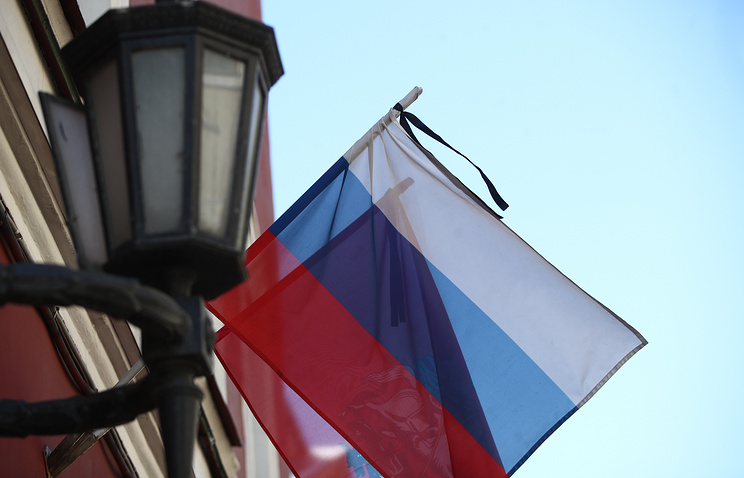 The Russian national flag flying at half-mast on the day of mourning for the Kemerovo shopping mall fire victims
