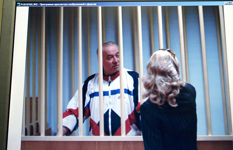 Sergei Skripal seen on a screen of a monitor outside a courtroom in Moscow, 2006