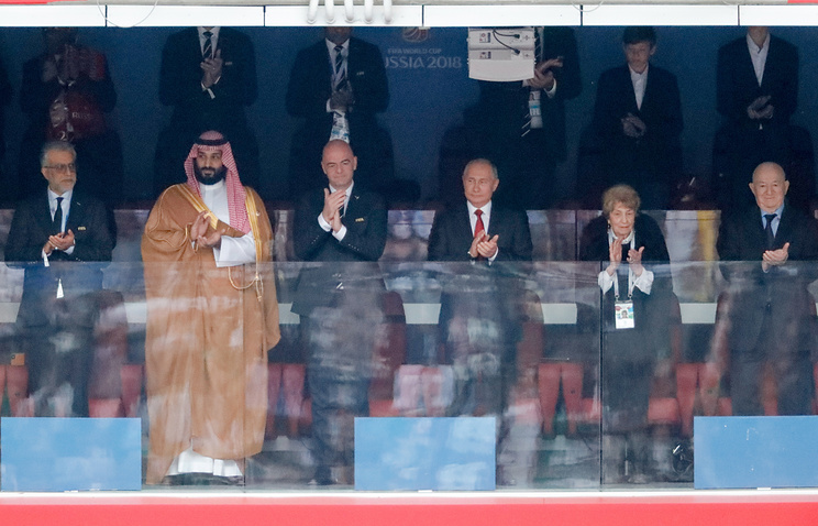 Russian President Vladimir Putin (center) and other officials attending the Russia-Saudi Arabia game in Moscow