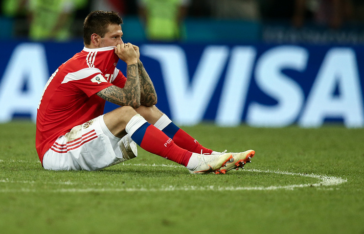Russia's Fyodor Smolov reacts after losing the 2018 FIFA World Cup Quarterfinal match against Croatia at Fisht Stadium. Croatia won the game on penalties 4-3.