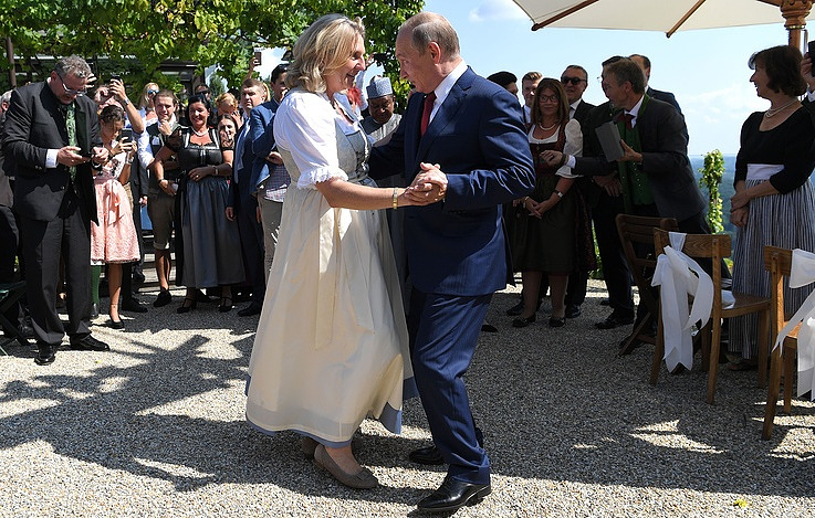 Austria's Foreign Minister Karin Kneissl and Russian President Vladimir Putin