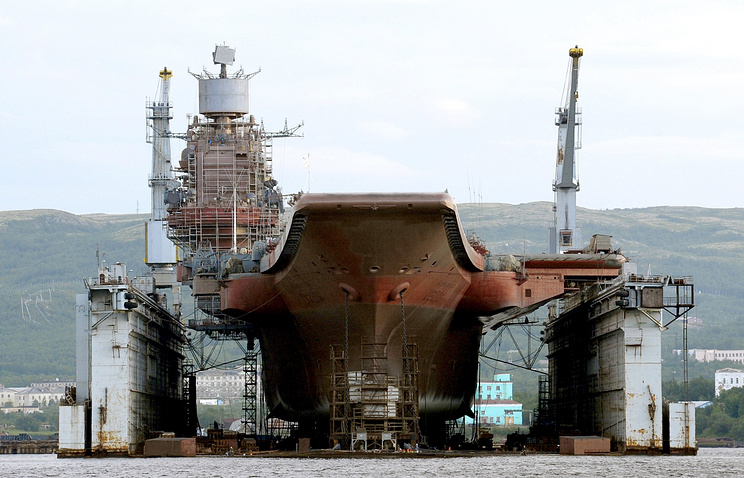 Russian aircraft carrier Admiral Kuznetsov at the PD-50 floating dock in Murmansk