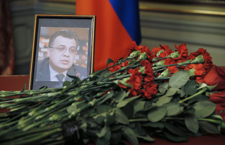 Flowers at a portrait of the murdered Russian Ambassador to Turkey Andrei Karlov