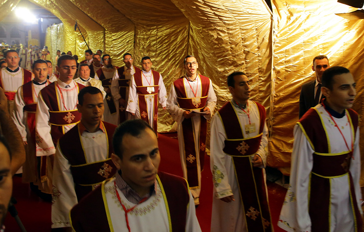 Egyptian Coptic Christians pray during an Easter mass