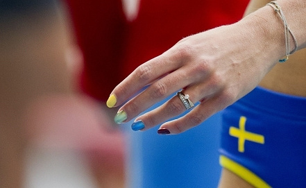 Emma Green, Swedish high jumper, wearing rainbow-colored nail polish during 2013 World Championships in Moscow. Photo EPA/ERIK MARTENSSON