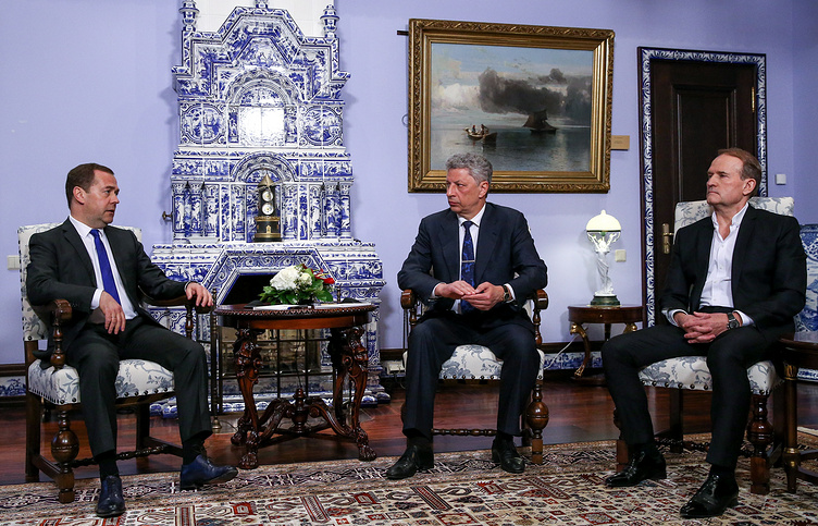 Russia's Prime Minister Dmitry Medvedev, Ukrainian presidential candidate Yuri Boiko and Head of the Political Council of the Opposition Platform - For Life party Viktor Medvedchuk