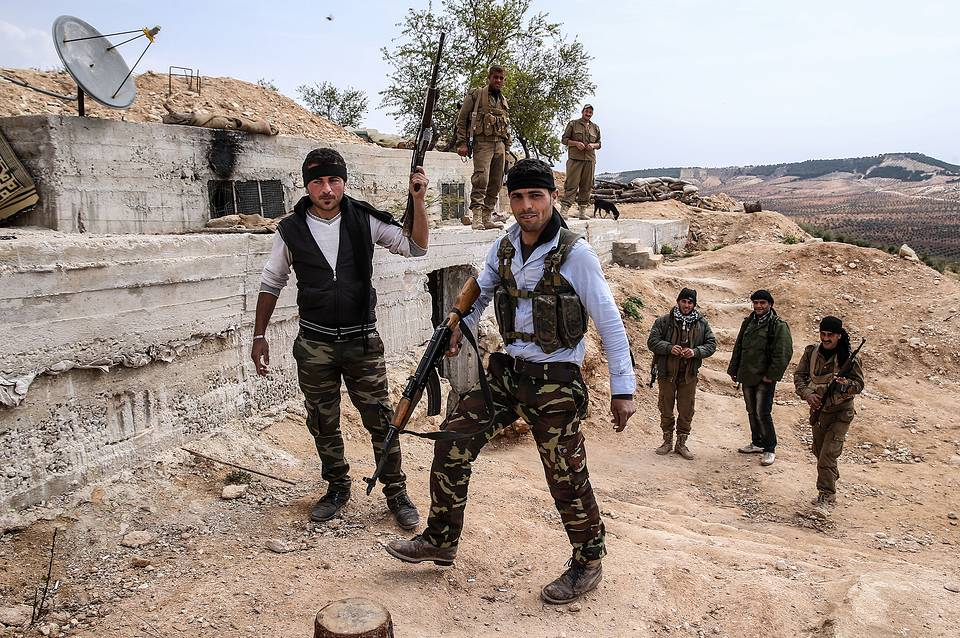 Armed Kurdish fighters near the town of Azaz on the Syrian-Turkish border, March 10, 2016 Valery Sharifulin/TASS
